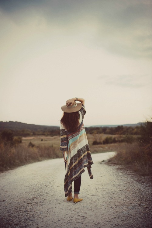 woman standing on road symbolizing transition life coaching